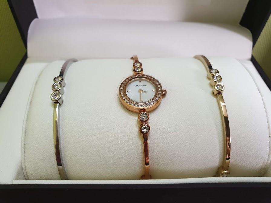 Đồng hồ nữ Anne Klein Women's AK/1690TRST Swarovski Crystal-Accented Rose Gold-Tone Bangle Watch and Bracelet Set